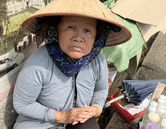 Vietnamese lady selling Catholic gifts in Ho Chi Minh